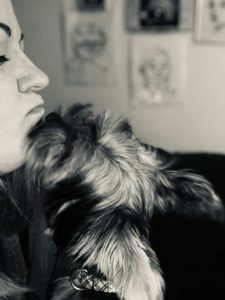 Yorkie and it owner kissing