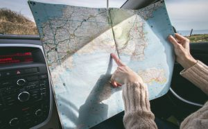 a person inside a car holding a map